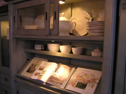Cupboard with white bowls