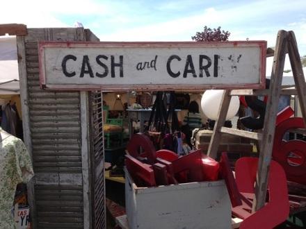 Cash and Cari Sign