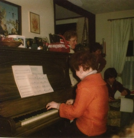 Lally at the piano