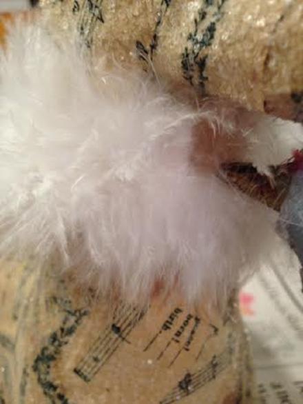 Anchoring feather boa with glue gun