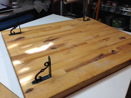 Brackets affixed to bottom of butcher block top