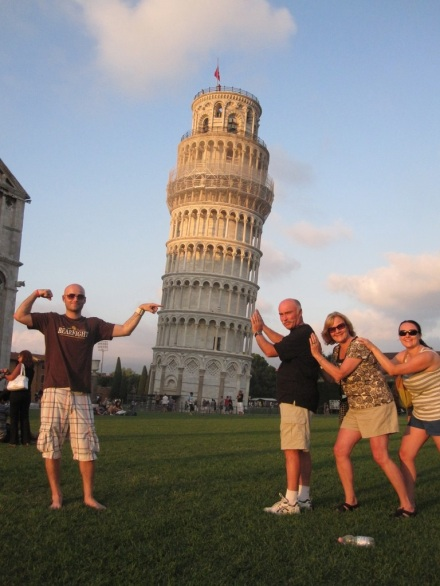 Family holding up leaning tower of Pisa