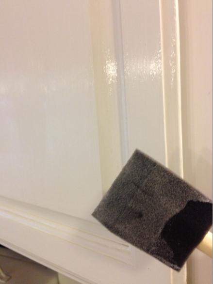 Foam brushing wax onto cabinets