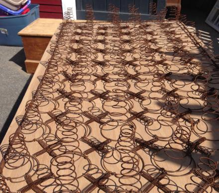 Rusty Bedsprings on Plywood Base